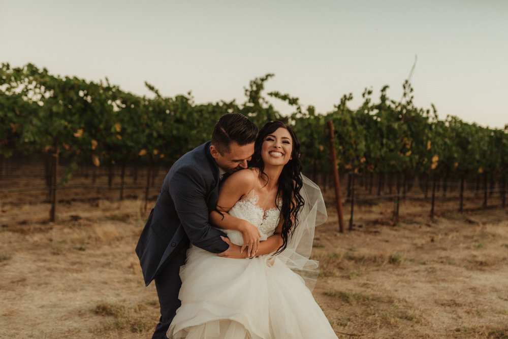 Ranch Victoria vineyard wedding couple hugging in the vineyard photo