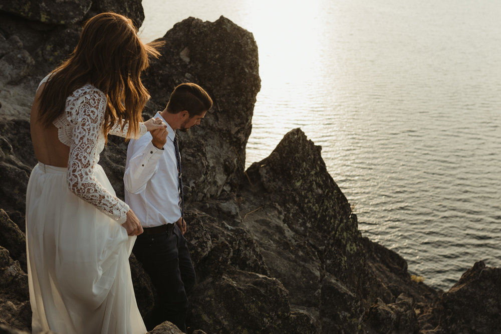 Lake Tahoe vow renewal couple walking down a cliff in Tahoe photo
