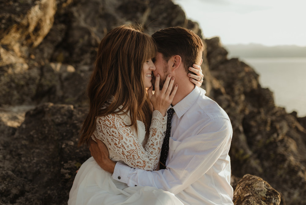 Lake Tahoe Vow renewal couple sitting on a cliff in tahoe photo