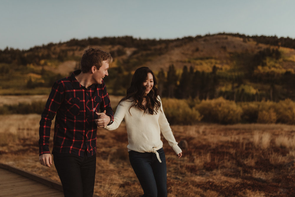 Tahoe meadows interpretive loop romantic sunrise session couple walking on a boardwalk photo