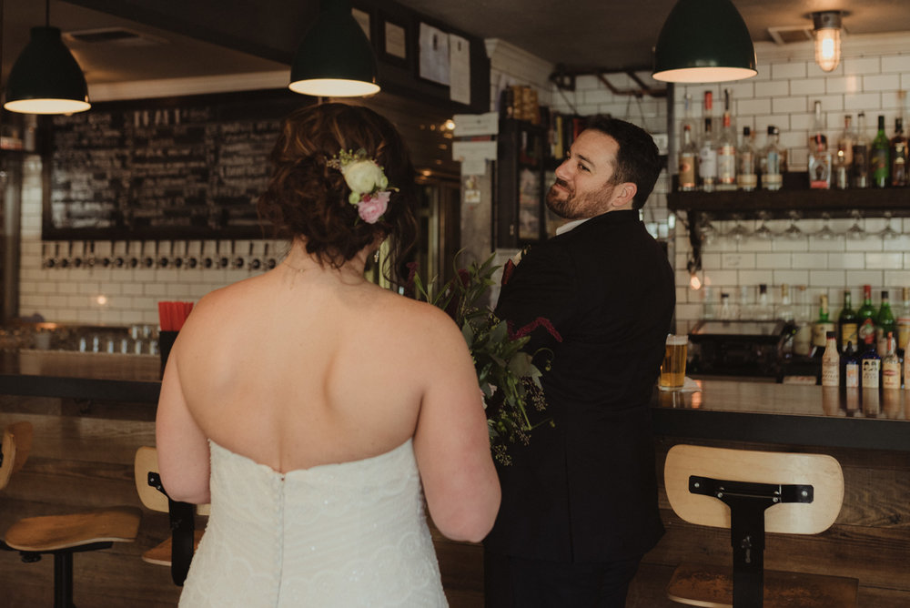 first look at a bar wedding photo