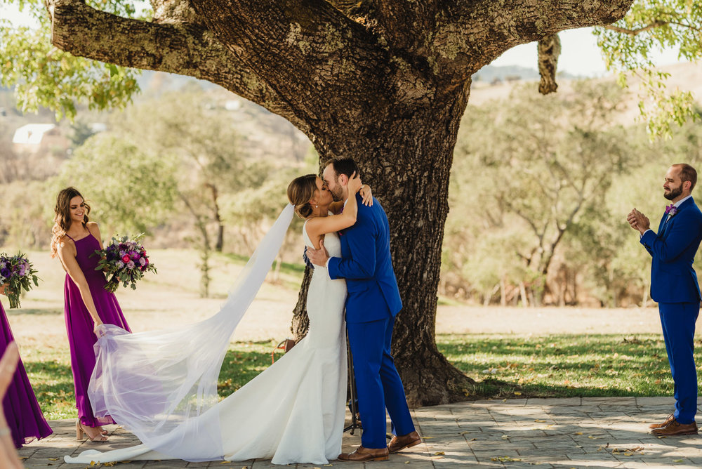 Triple S Ranch Wedding Venue, first kiss during the ceremony photo