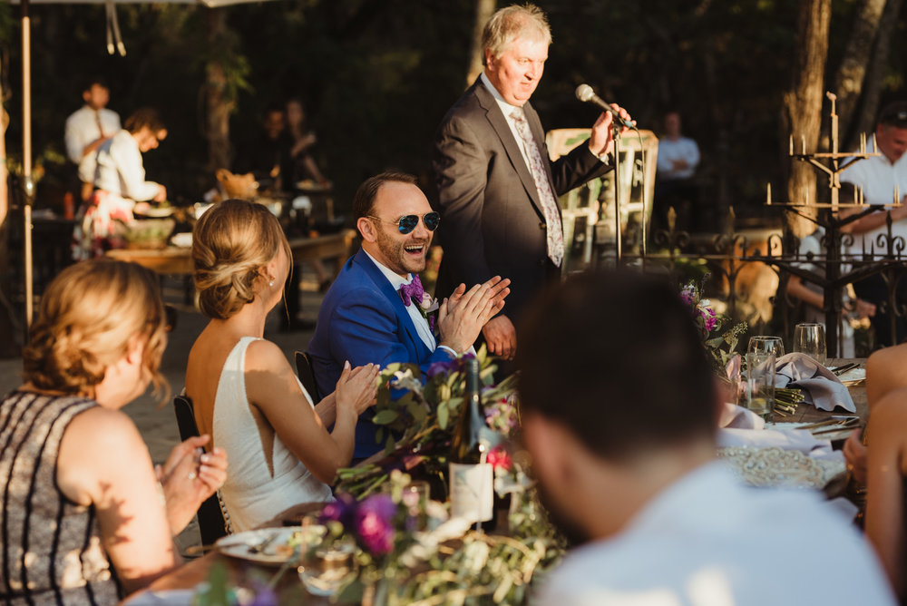 Triple S Ranch Wedding Venue, groom laughing during toasts photo
