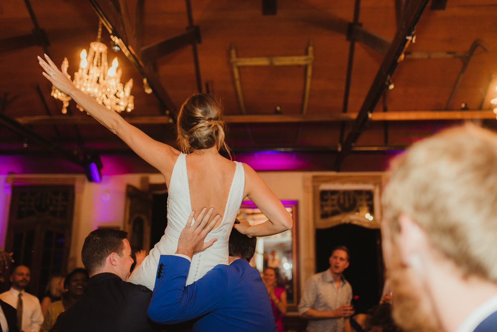Triple S Ranch Wedding Venue, bride getting picked up on the dance floor photo