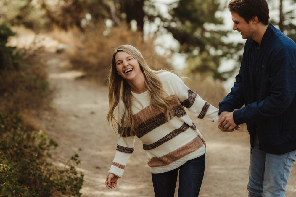 Cave Rock engagement session inspiration at Lake Tahoe, couple walking on a trail photo