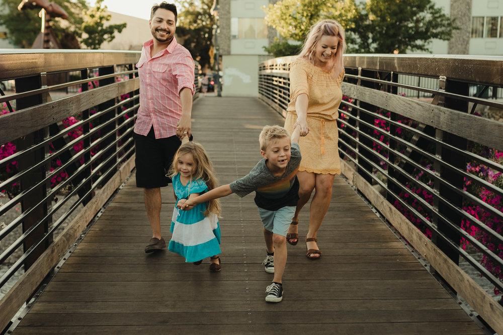 babies & kids family photo: family candid photo walking on a bridge