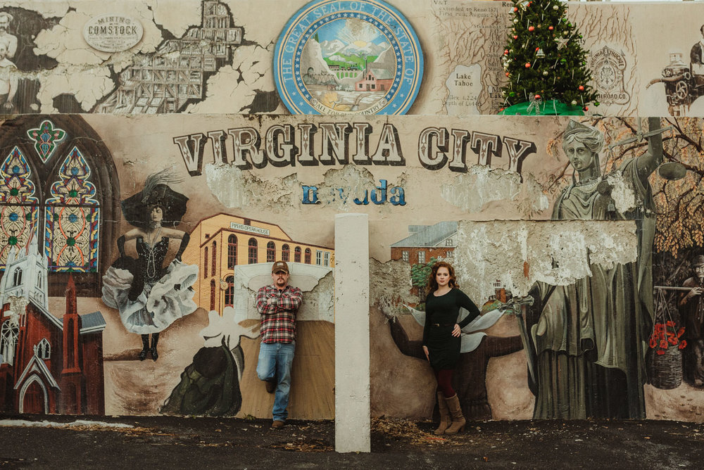 Virginia City Engagement session, couple in front of a mural in Nevada