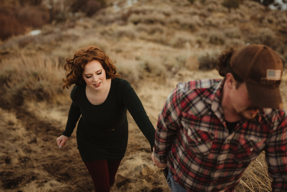 6 mile canyon engagement session, couple hugging at sunset photo