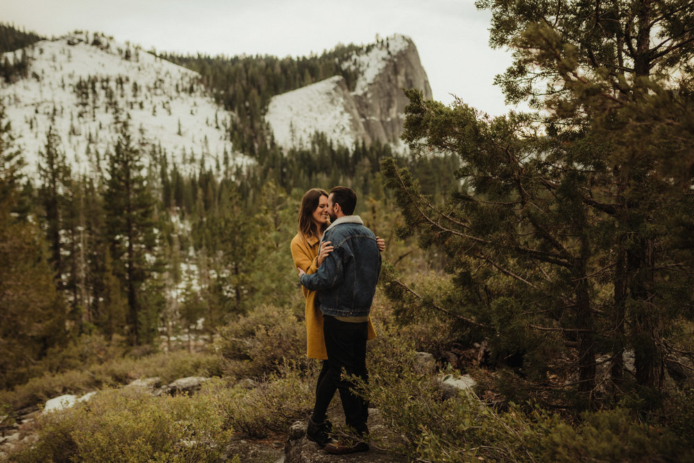 Strawberry California engagement session, couple hugging with lovers leap in the background