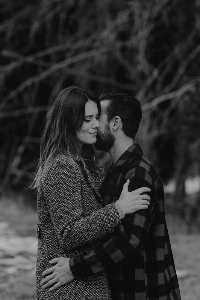 Strawberry California engagement session, couple hugging in the meadows, black and white photo