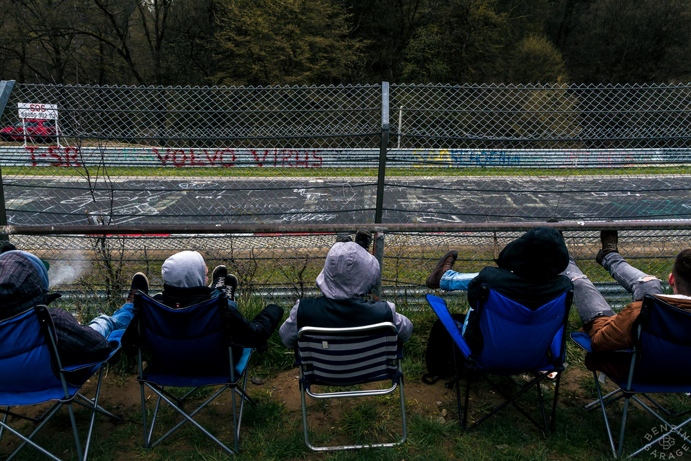 Spectators all along the fencing at the 12-mile Nordschleife dressed to keep warm.