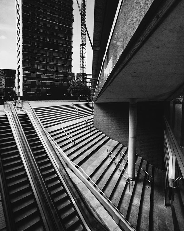 This image could have been much better just by having someone walking up the stairs. It would have given so much more life to the image and some scale. We thought about compositing someone in but decided against it to show not every image needs to be perfect. Some images can act as a lesson for future works.  Shot with the iPhone X and the wide angle HD lens from @rhinoshield . . . . #rhinoshield #iphone #iphoneonly #shotwithiphone #shotoniphone #architecture #building #city #barcelona #blackandwhite #city