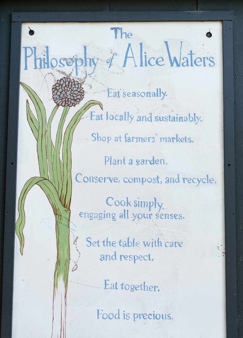 Alice Waters ' philosophy on slow food and eating posted at the Edible Schoolyard at Martin Luther King Middle School in Berkeley. | Credit: Jason Henry