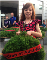 Bella laying a wreath on behalf of Australian children at an ANZAC Dawn Service in China.