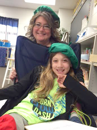 3rd grade teacher Lisa Jasper and student share a smile as they wear their character berets.