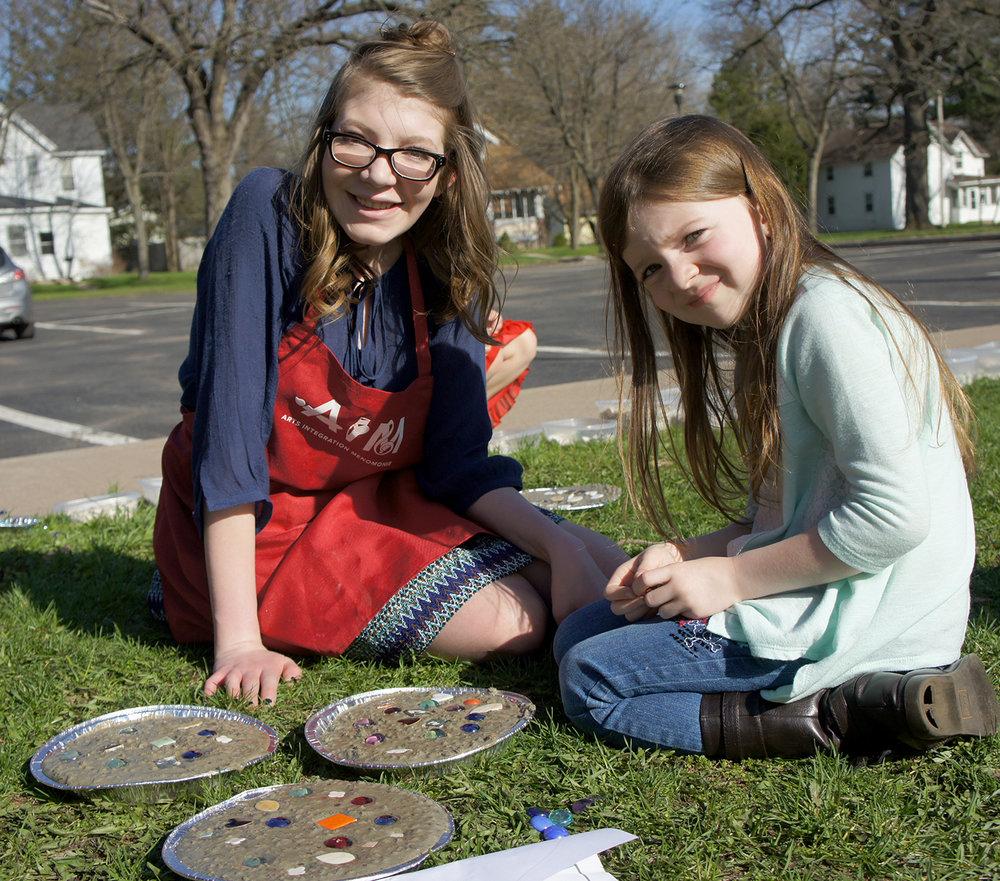 "Intern Elizabeth Rosendahl teaches stepping stone projects as part of her Arts and Crafts"" internship at Jumpstart Afterschool Program for grades K-5."