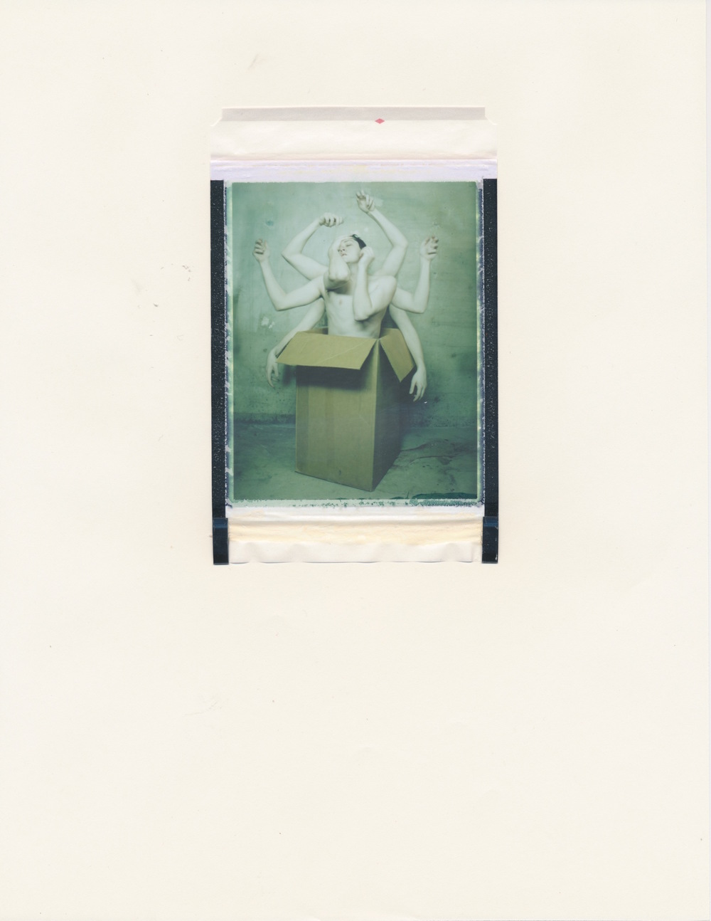 Human Obscura #9 (Figure in Box 2)   2015  Diffusion Transfer Print on Paper  8.5x11