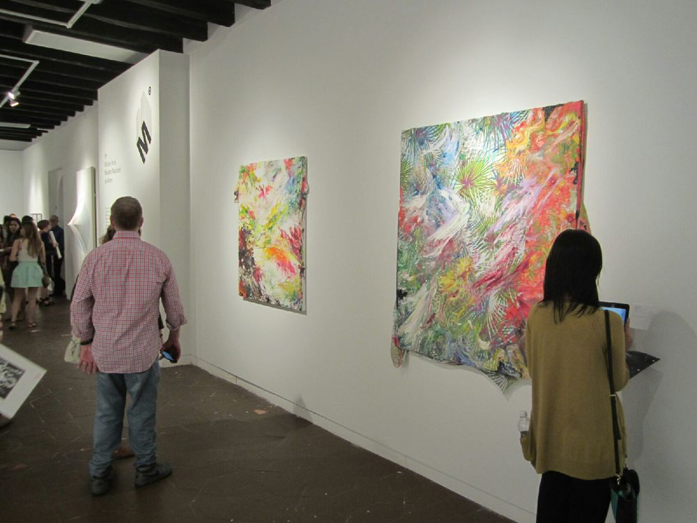 "Sebastian Vallejo's ""Lush"" and ""Corazón al Sol"" paintings at Museo de Casa Blanca beside Zilia Sánchez' works of art."