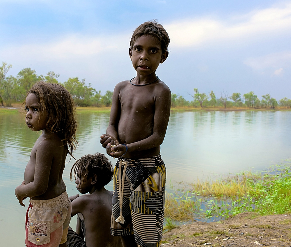 Children at Bayulu living water, remote Kimberley Region. Australia.