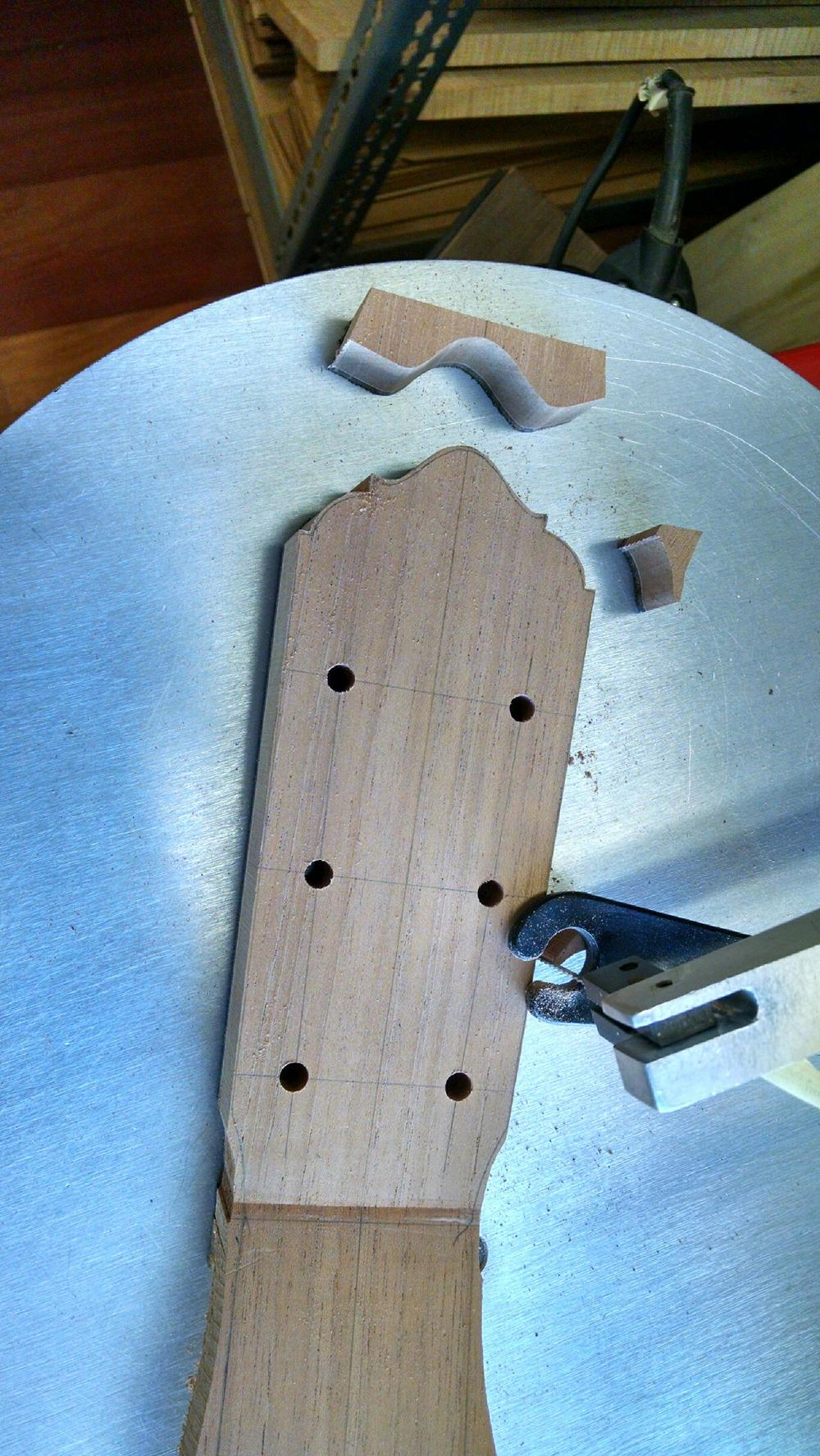 Scroll sawing head design.
