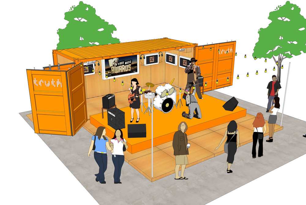 Envisioned as an easily transformed mobile space, the shipping container needed to open from the side, have a fold-out stage, wall-to-wall hardwood and hardwired TVs and Listening stations.