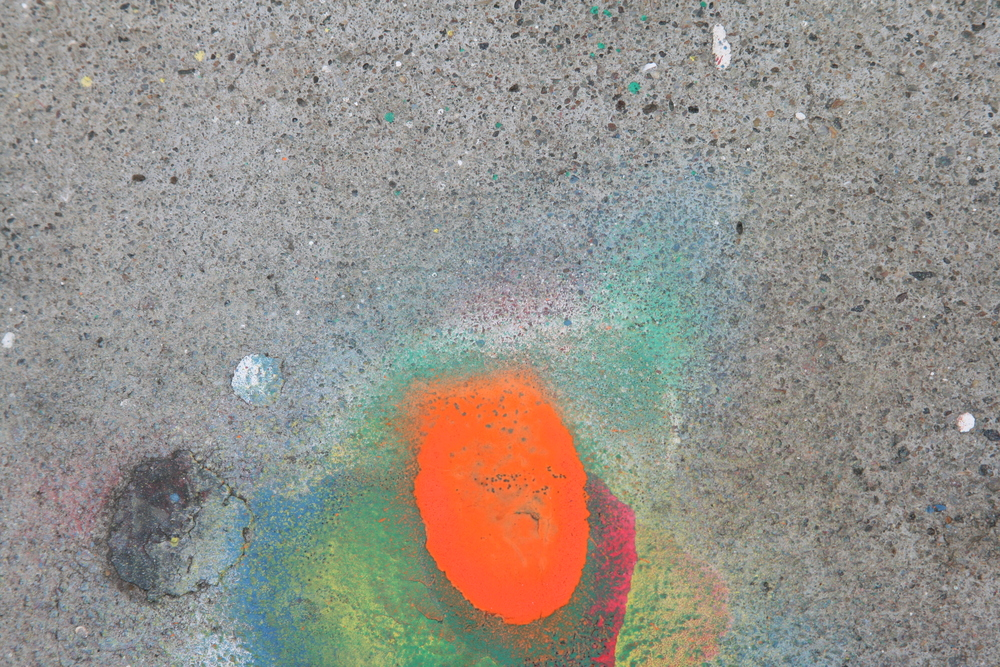 Orange Spraypaint on Concrete by Sherrie Thai is licensed under CC BY 2.