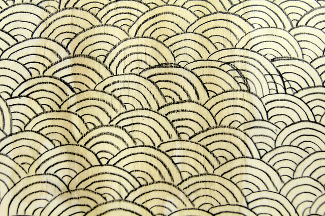 waves drawn on plywood detail by Gillian McCarthy is licensed under CC BY 2.0