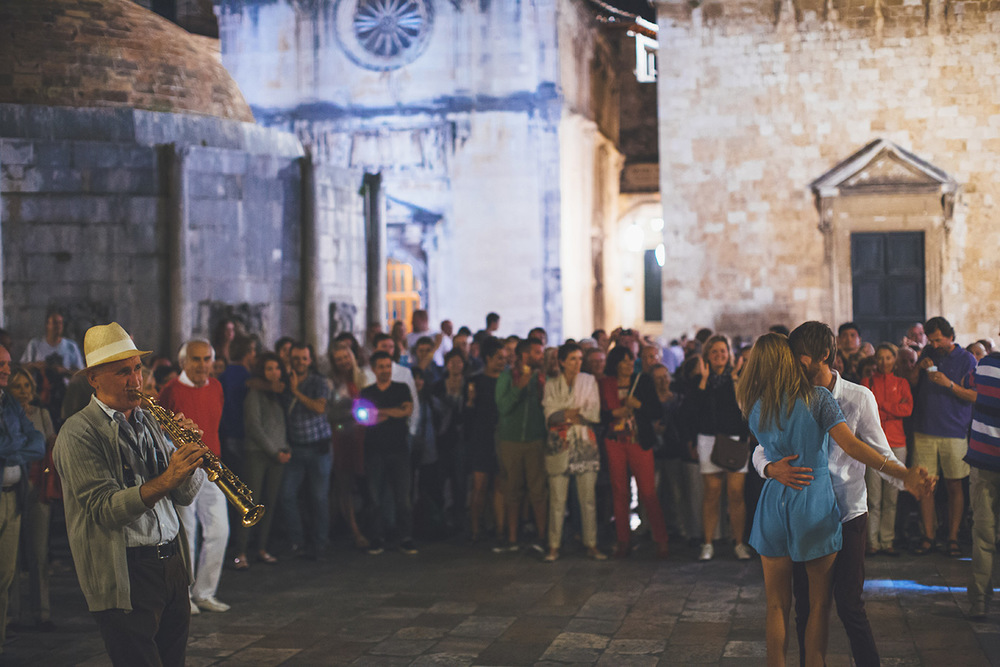 One of a set of images taken at this chic destination Wedding of Jenna & Nick. The stylish old town of Dubrovnik, Croatia.  The couple dance in the streets.  Photography by Matt Porteous