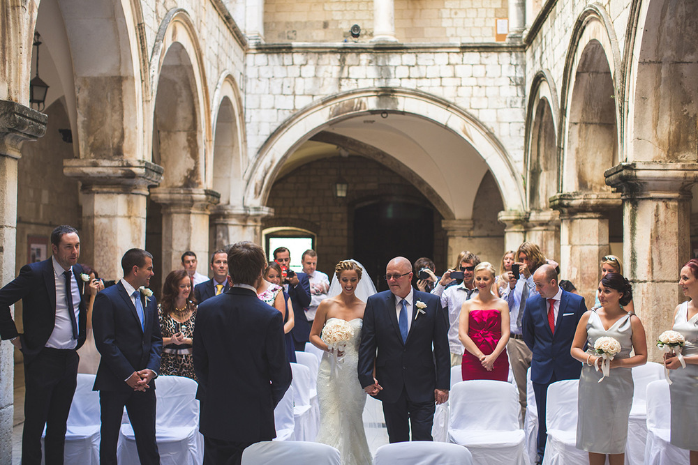One of a set of images taken at this chic destination Wedding of Jenna & Nick. The stylish old town of Dubrovnik, Croatia.  The Congregation await.  Photography by Matt Porteous