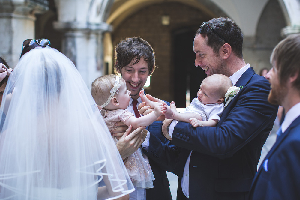One of a set of images taken at this chic destination Wedding of Jenna & Nick. The stylish old town of Dubrovnik, Croatia.  Babies with the Bride and Groom.  Photography by Matt Porteous