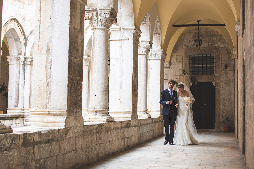 One of a set of images taken at this chic destination Wedding of Jenna & Nick. The stylish old town of Dubrovnik, Croatia.  The couple walk hand in hand.  photography by Matt Porteous