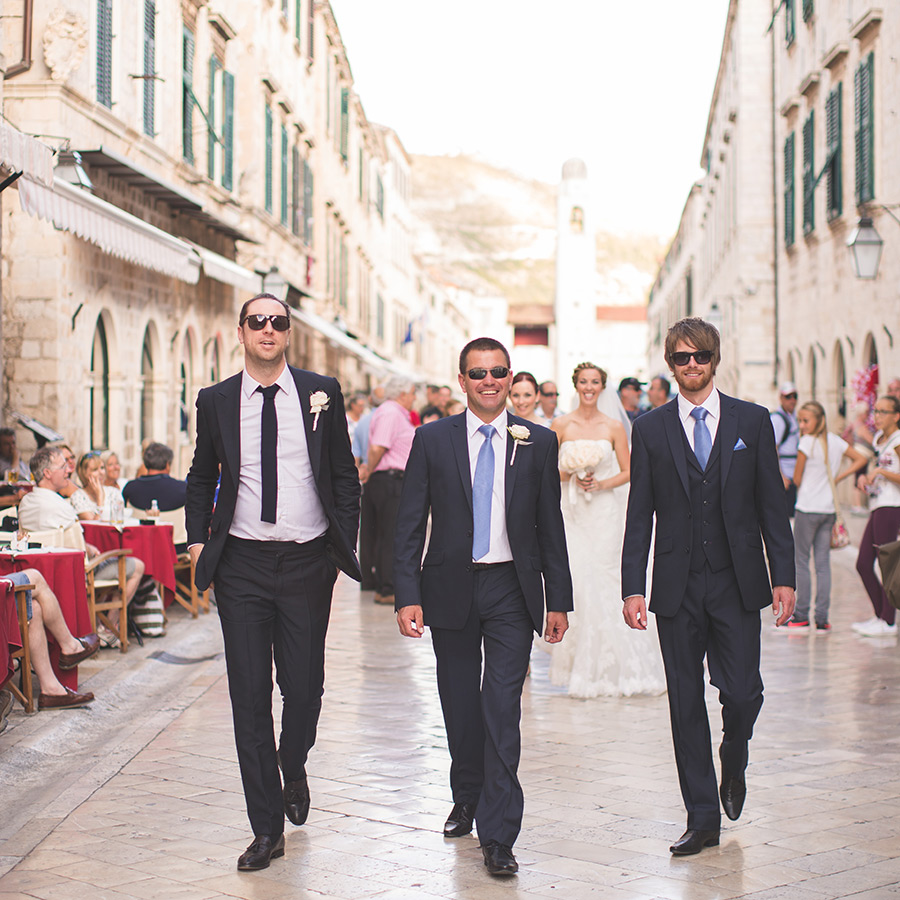 One of a set of images taken at this chic destination Wedding of Jenna & Nick. The stylish old town of Dubrovnik, Croatia.  The men in navy blue.  Photography by Matt Porteous.