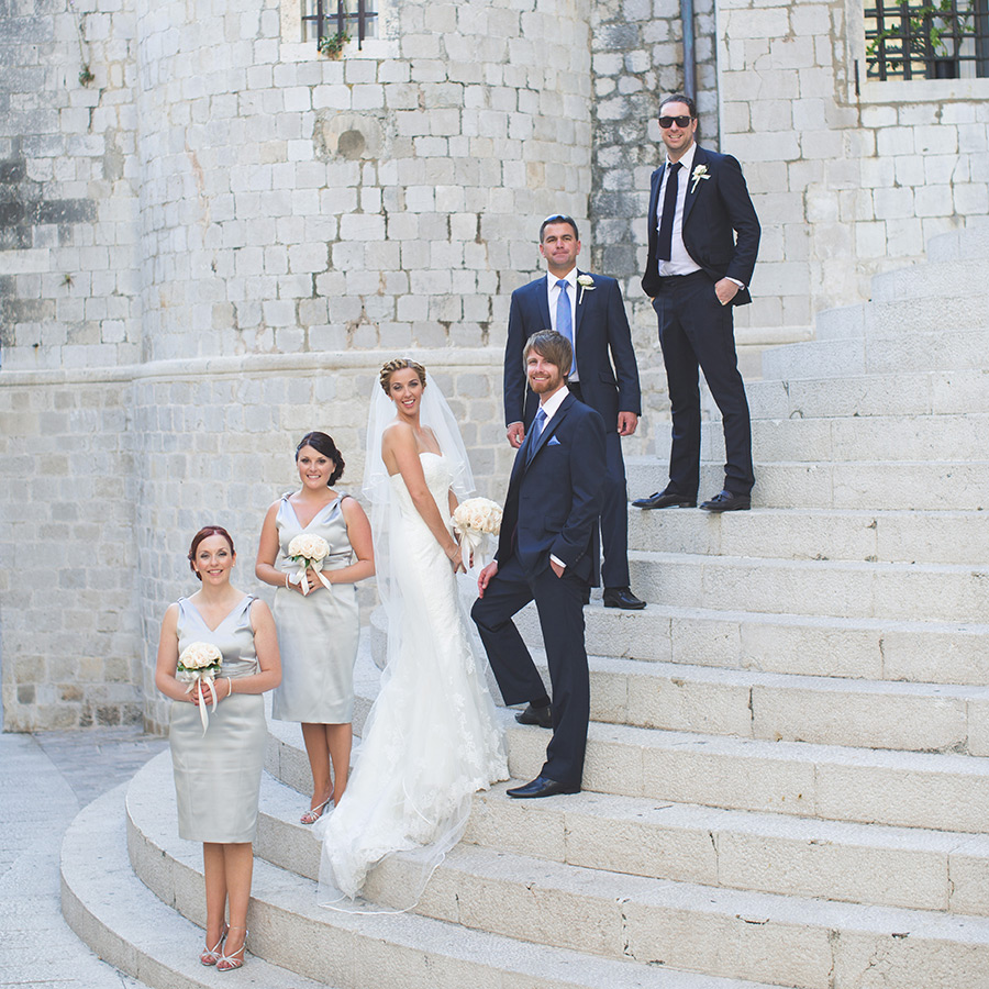 One of a set of images taken at this chic destination Wedding of Jenna & Nick. The stylish old town of Dubrovnik, Croatia.  The Bridal party & Groomsmen pose on the stairs.Photography by Matt Porteous
