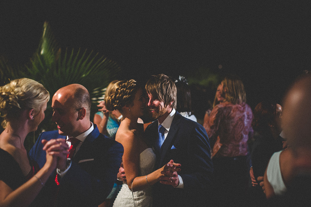 One of a set of images taken at this chic destination Wedding of Jenna & Nick. The stylish old town of Dubrovnik, Croatia.  The couple dance outside in the warm evening.  Photography by Matt Porteous