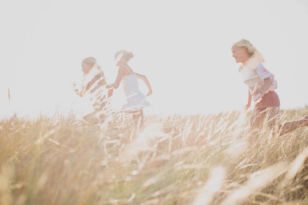 Children Running Through Grass