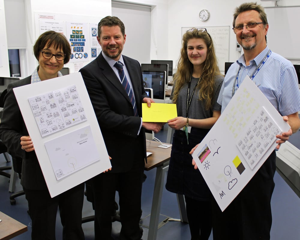 PHOTOGRAPH shows Remley Mann, Principal at King Edward VI College with the new card (left), James Rennison, Managing Director at Kendrick Homes Limited presenting the prize toNaomi Reed, and Stewart Monk, subject leader for graphic design at King Edward VI College holding part of Naomi's artwork submission (right)