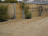 Garden patio with wooden decking fence enclosure.