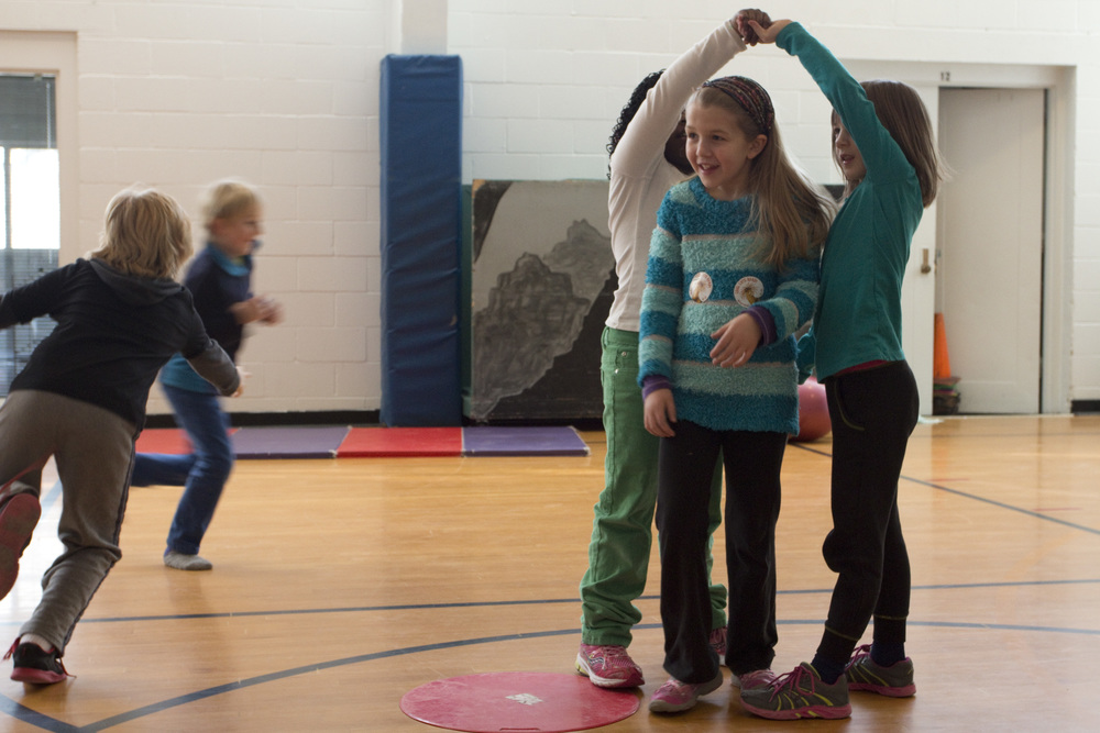 Student's play 'squirrel get your tree' tag game. This game incorporates children's imagination with movement. During gym class, Kim McKeon strives to help children discover their own personal connection to active movement – whether that is through sports, running, stretching or play.
