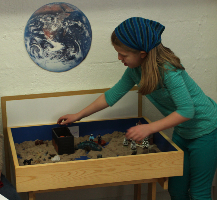 Heard of Sandtray WorldPlay? Our younger students currently have the unique opportunity to work with Pat Taylor, (former primary teacher of 30 years) to create a world using sand, miniatures, and figurines. They then tell a story about that world. The activity promotes creativity and language through play and storytelling.