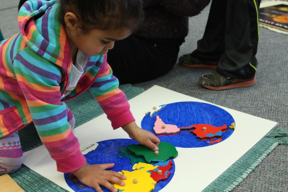 The connection to the wider world is supported in classroom activities with cultural materials, song, dance, and art.