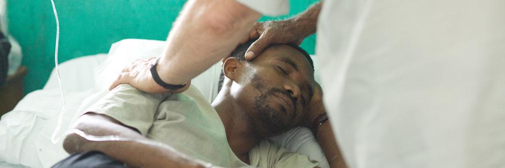 Prayer for Pastor in Les Cayes Hospital slider.jpg