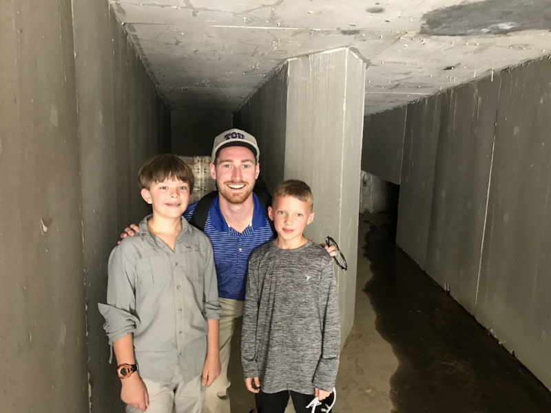 Jackson and Andy with Chad Duncan, our Impact Advisor and occasional babysitter, inside the collection unit (dam) at Blue Energy's first hydro project.