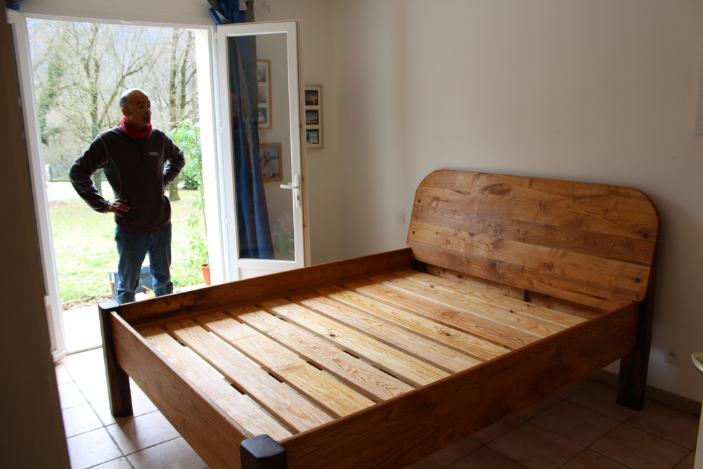 Finished custom made bed 190 cm by 200 cm, Oak legs with a chestnut frame.