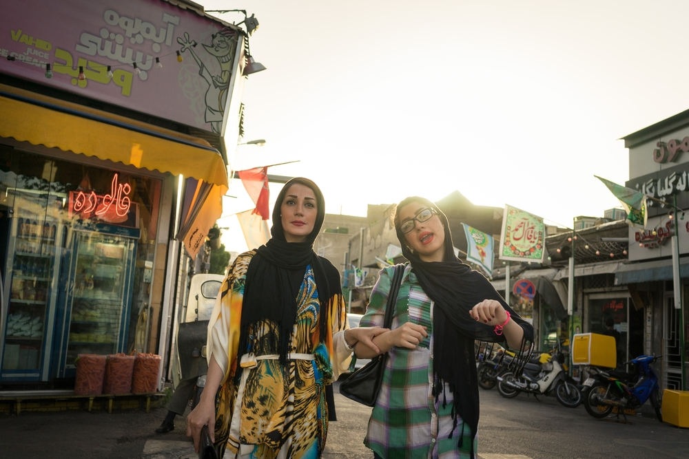 Two young women shop in the streets of Tehran.