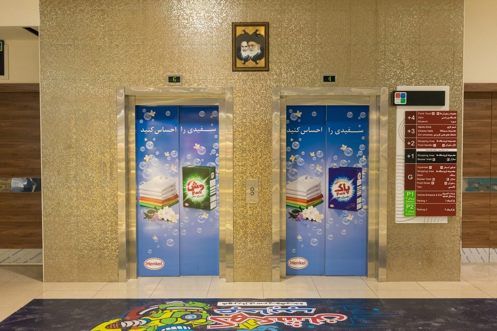 "Two elevators in Isfahan City Center mall advertise ""Pak,"" a popular local detergent brand manufactured by Germany's Henkel. Henkel gained an Iranian subsidiary, Henkel Pakvash, through the acquisition of Iran's Pakvash Company in 2002. The company's shares are now traded on the Tehran Stock Exchange."