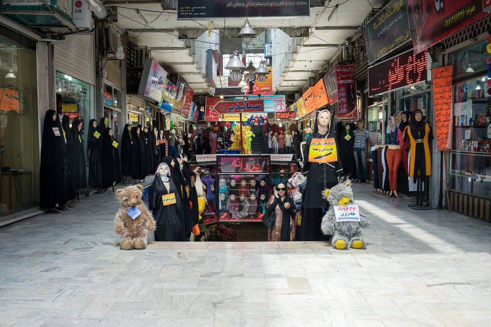 A view of an old shopping arcade selling women's clothing in Shiraz.