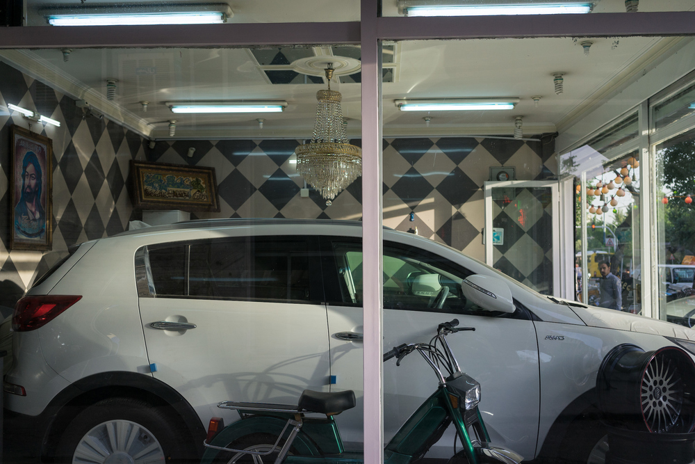 A small shop sells a late-model car in Tehran. Many of the newer, foreign cars on Iran's streets were imported to the country by individuals dealers and sold through such small shops with limited inventory. Following the lifting of sanctions, foreign manufacturers are now working with official agents to establish dealer networks in the country with full after-sales services.