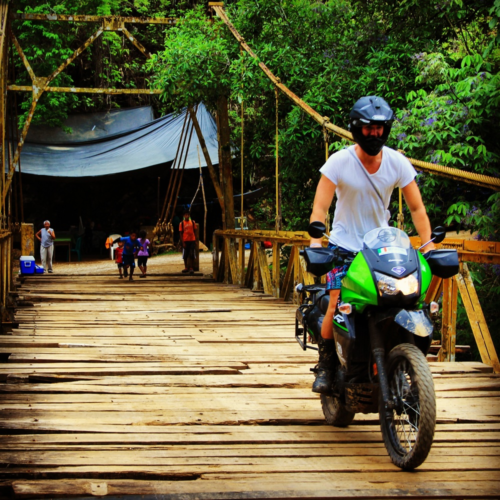 Traversing a less-than-optimal bridge outside Semuc Champey. Photo by Elise Ronfart.
