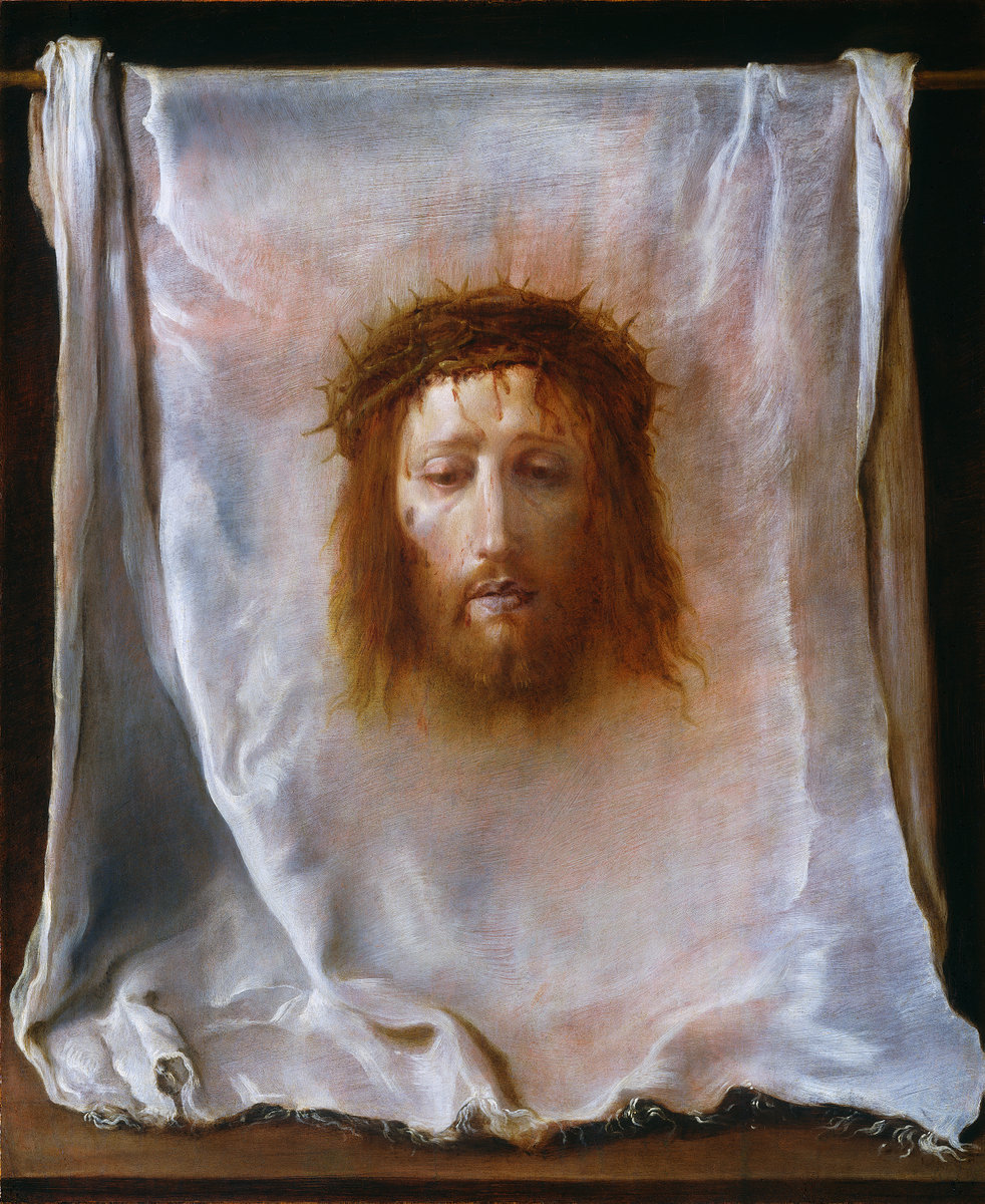 "This painting got my attention today when I saw it in the National Gallery of Art. Domenico Fetti painted ""The Veil of Veronica"" around 1618.  Fetti was in Rome in 1606 when the Veil of Veronica, one of the oldest and most venerated relics in Christendom, was installed in the crossing of St. Peter's Basilica. According to medieval legend, the veil belonged to a woman who took pity on Christ as he toiled with his burden of the cross to Golgotha. She gave Christ her kerchief to wipe his brow, and when he returned the cloth, his image miraculously had been impressed upon it. This kerchief was believed to have been preserved as the relic called the ""true image"" or, in Latin,  vera icon  . In time, these words combined to form ""Veronica,"" the name given by legend to the compassionate woman at Golgotha.  The image is now kept in a remote monastery in Manoppello, Italy where Pope Benedict XVI visited to see it 2006.  It's interesting to note that when the first photo negatives were taken of the Shroud of Turin in 1898, the injuries to the nose on the face appearing on the shroud match up with the injuries which appear on the veil.  We won't know for sure what Christ looks like until we get to Heaven but Domenico Fetti did a masterful job capturing the anguish on the face of the man which might have been Christ on his way to the Cross."
