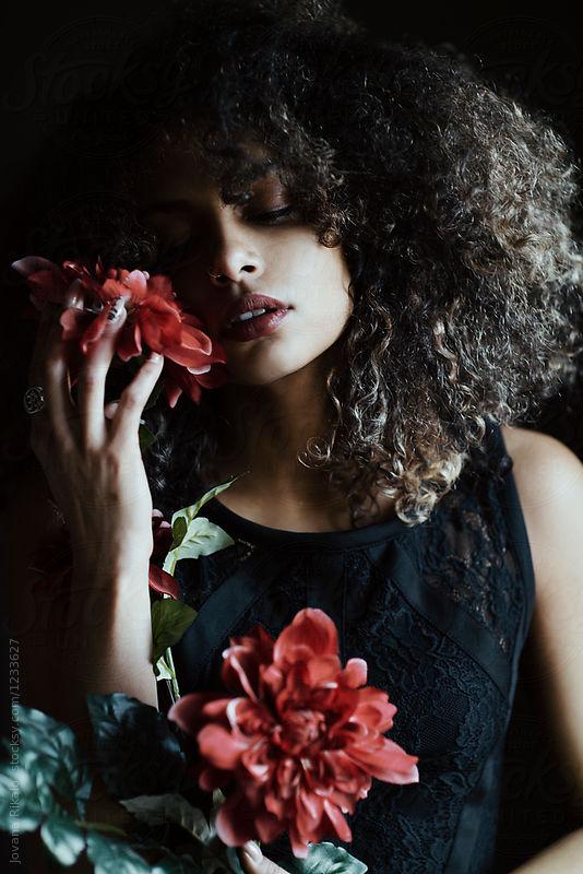 Bae Holding flowers-stocksy.jpg